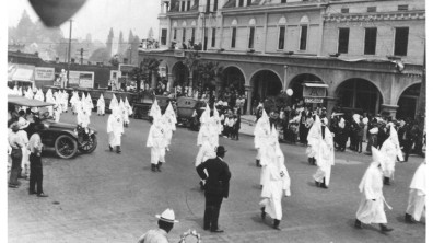 A Ku Klux Klan March in Ashland, Oregon (Date unknown; estimated to be from the 1920s) OREGON HISTORICAL SOCIETY)